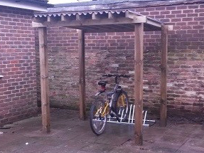 To remove old run down shed to covered bike shelter.