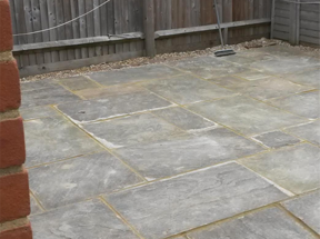 Relay and re-point paving in rear garden
